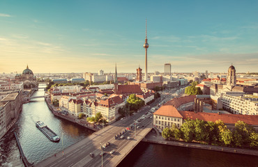Berlin skyline with Spree river at sunset with retro vintage filter effect, Germany