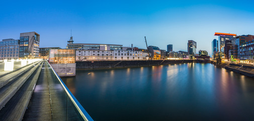 Panorama view of the Media harbor in Dusseldorf in the early evening, Germany. Nice reflection in the harbor basin.