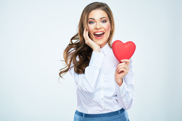 Happy woman hold red heart. Long curly hair. Beautiful female m