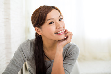 Asian young woman relaxing at home