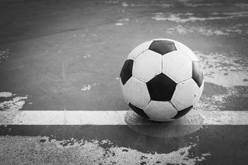 black and white old ball at kick off point