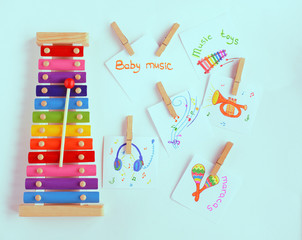 Colorful baby xylophone with stick isolated over white background