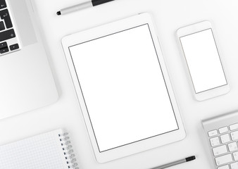 Responsive design: top view on laptop tablet and smartphone on white table background with text space and copy space.
