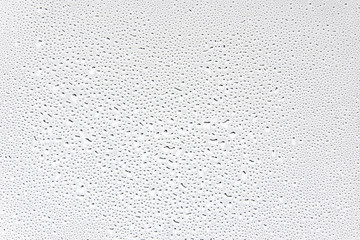 Water drops on glass background texture.