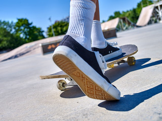 Legs skateboard close up  in skatepark. Low section of skate.