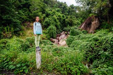 backpacker girl travel in tropics forest of Vietnam