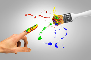 Miracle creation of creative man by colorful paintbrush