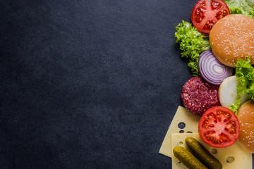 Dark restaurant menu, burger ingredients and copy space