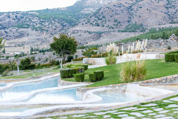 Travertine pools with beautiful green landscape