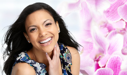 Beautiful Asian woman face over floral background.