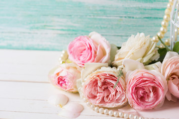 Postcard with  pink roses flowers  on white painted wooden backg
