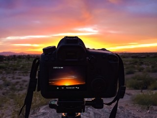 Camera and sunset sky