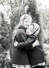 Photo in retro style. Cute little girls (sisters 3 and 4 years)