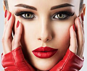 Beautiful woman with bright  fashion make-up.