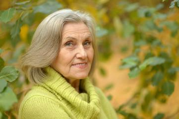 senior woman in  autumn park