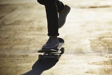 Young Man Skating at Sunset