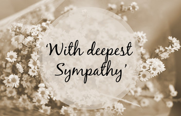 """With deepest sympathy"" note on small flower sepia tone"