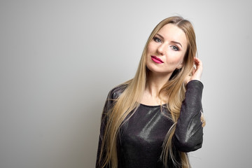 Fashion model with bright makeup. Portrait of young fashion woman with long blond hair