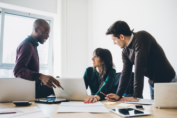 Multiracial business people working connected with technological