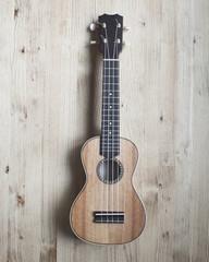 ukulele on wooden background. close up