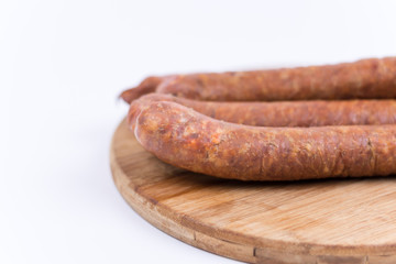 Raw sausages isolated on white