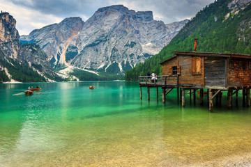 Wall Mural - Wooden boathouse on the alpine lake,Dolomites,Italy,Europe