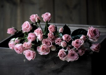 Pink roses in a wooden crate