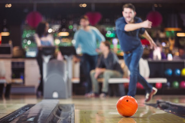 bowling ball is rolling towards the pins