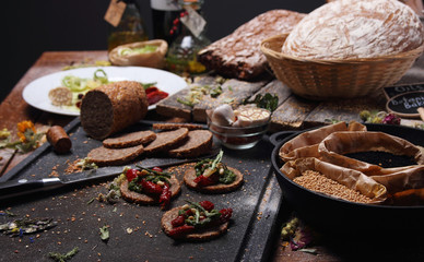 Grain bread and different spices on the table..