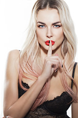 beautiful blond girl with chubby red lips and finger near the lips