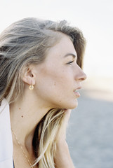A woman with long blonde hair, profile,