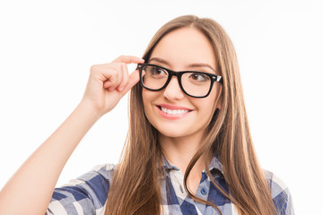 Close up portrait of smiling smart woman touching her glasses