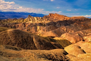 Wall Mural - Beautiful glow over Zabriskie Point at dusk, Death Valley National Park, California