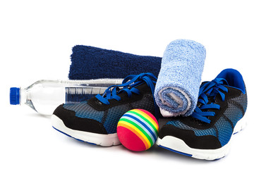 Sport shoes, towels, ball and water bottle.