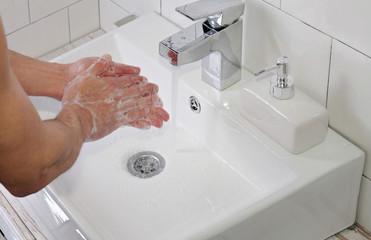 Hygiene concept. Man washing hands close up