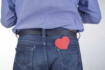 Man with a red heart is his back pocket