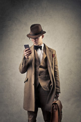 Elegant man checking his smartphone