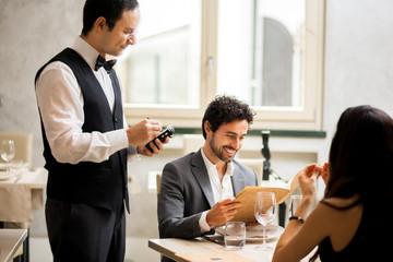 Waiter taking orders in a restaurant