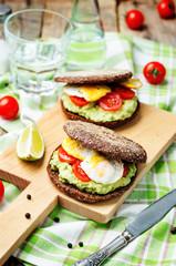 smashed avocado, tomatoes, egg sandwich