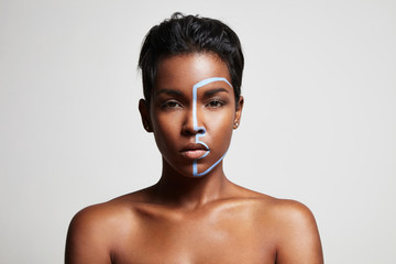 woman looks at camera with a blue line on a face