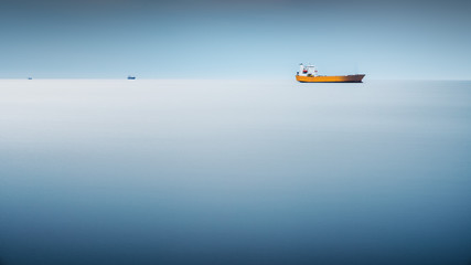 Cargo ship in the sea - long exposure to have the sea like an abstract background