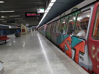 Bucharest, Romania, March 13, 2016: Passengers are traveling old trains of metro, covered by graffiti, in one of the newest line.