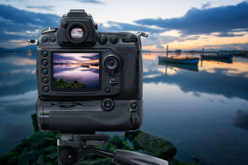 Reflex Camera on tripod near the lagoon, performing a long exposure at sunset