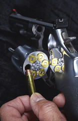 Man Loading Magnum Revolver Closeup