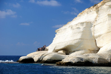 Group of tourists at the rock seashore of Rosh hanikra. Israel.
