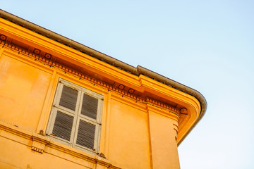 Typical architecture detail of a red painted house in the Provence region, France, city of Aix-en-Provence
