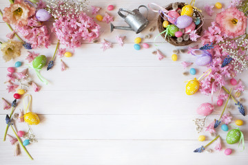 Easter background with flowers hyacinth, nest and colored eggs