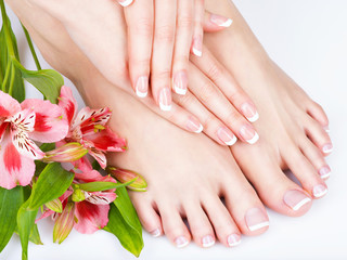 female feet at spa salon on pedicure and manicure procedure