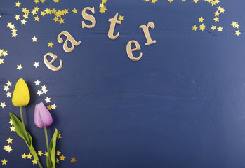Gold Easter Letters on Wood Background.