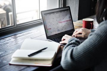 Asian Lady Typing Laptop Calendar Cafe Concept